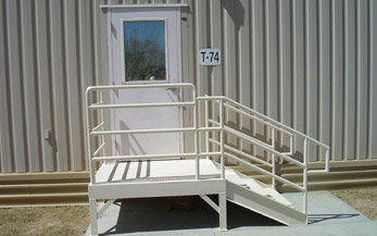 Picture of a metal building with metal stair rails.